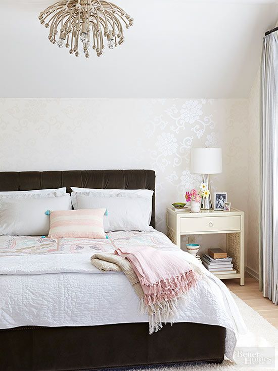 Give your bedroom a tasteful dose of glam with a slightly shimmery wallpaper and clean neutral colors.: