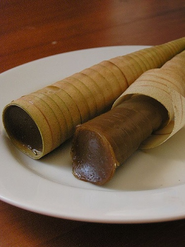 Kue clorot, the sticky dough of glutinous rice flour sweetened with coconut sugar filled into the cone-shaped janur (young coconut leaf), and steamed until cooked.