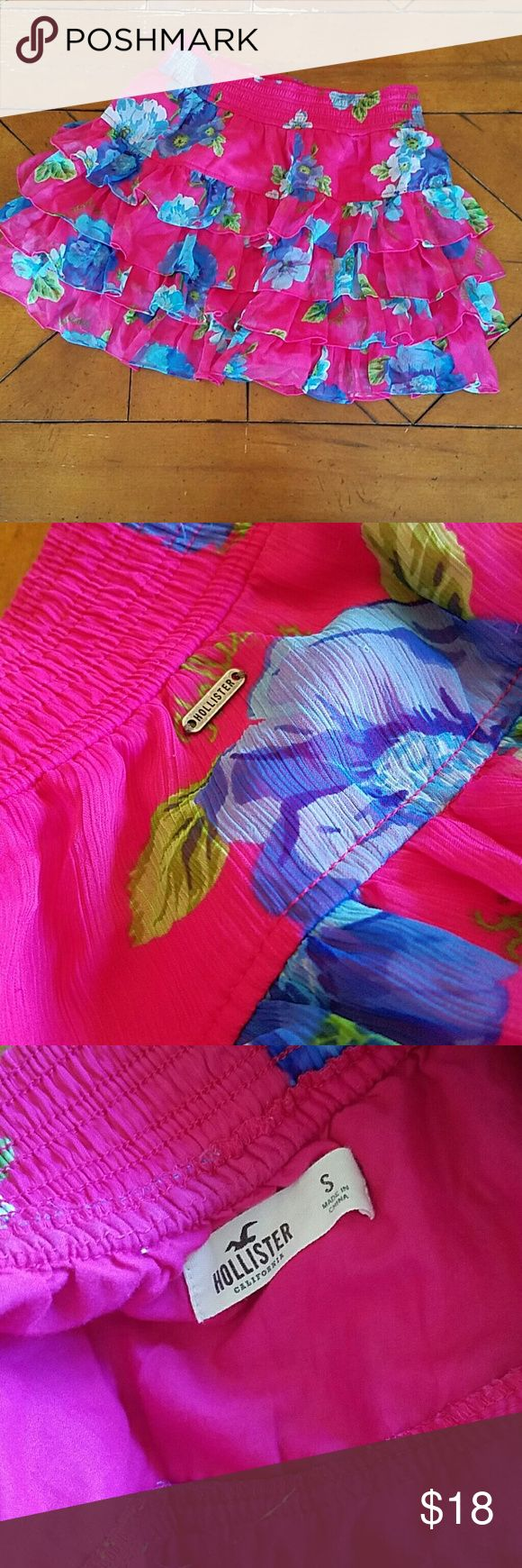 Cute Hollister Mini Ruffle Skirt Size S small Hollister skirt. Mid to high thigh, layered ruffles, hot pink with blue flowers. Adorable. Like new. NWOT Hollister Skirts Mini