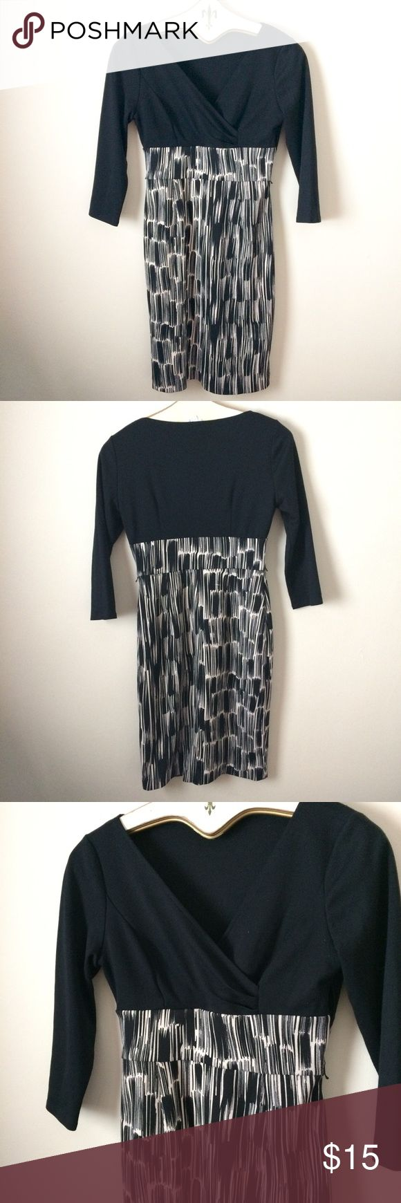 London Times black and white 3/4 sleeve dress London Times black and white 3/4 sleeve dress. Perfect for work or dinner. Size 4. Has loops for a belt but does not come with a belt. London Times Dresses