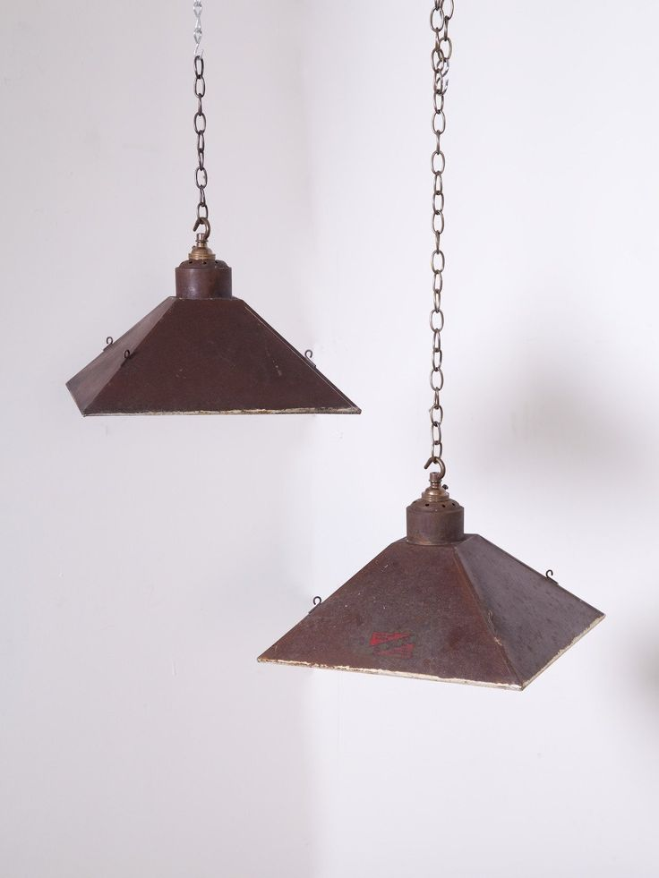 Factory work lights manufactured by B & H of Birmingham.  Folded steel shade with mirrored interior, one light has had all mirrors replaced.  English 1950s