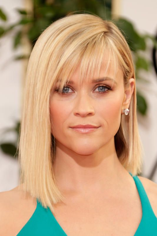 Reese styles new wispy bangs with her blunt, side-parted buttery bob. So far, so good. But her coppery eyeshadow looks like she went a few rounds in...