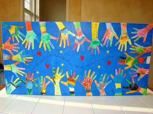 "Open House or Back to School Night project...create mural for wall outside classroom. Says: ""With heart and helping hands, a child can accomplish anything."""