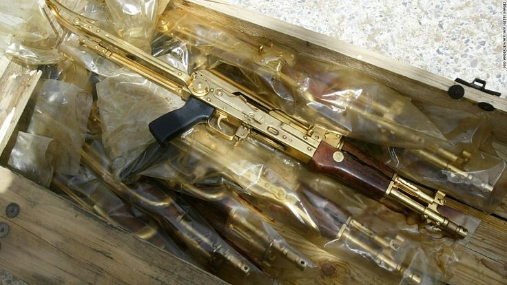 "Gold Kalashnikov rifles with the Arabic inscription ""A gift from Iraqi President Saddam Hussein"""