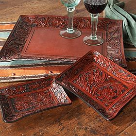 TOOLED LEATHER TRAY     Hand tooled leather covers the small and medium trays while the large tray has smooth leather inlay in the center.