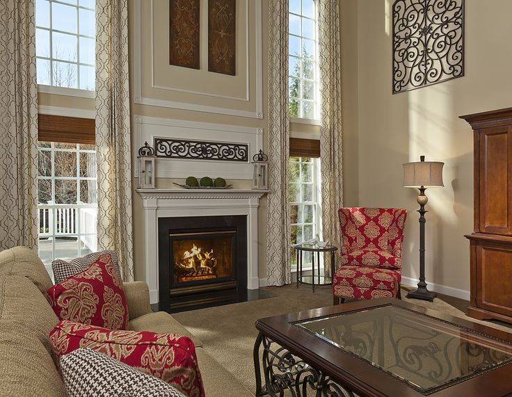 This lauren nicole designs family room was created to showcase the beautiful windows and create a cozy and elegant place to entertain friends