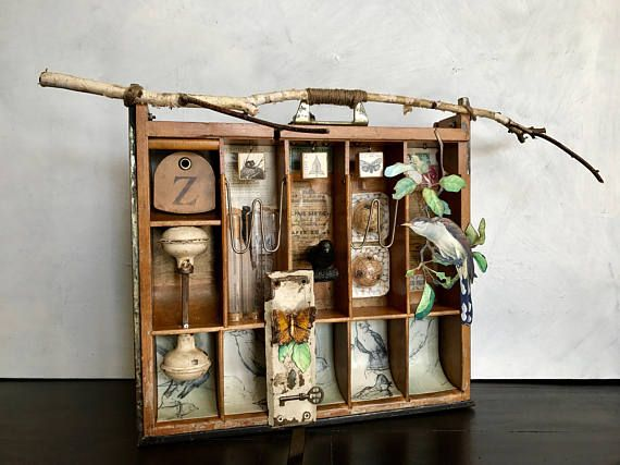 I did this piece of assemblage art while reading the book Utopia Parkway about the grandfather of assemblage art, Joseph Cornell. This piece is in homage of this wonderful artist. I started with an old wooden cash drawer I found at a flea market, and in keeping with many of Cornells pieces, this one includes birds and nature. Coin cubbies with line drawings of birds, door knobs and door plate, blocks with dictionary pages added on, test tubes, along with all the original papers stuck in the…