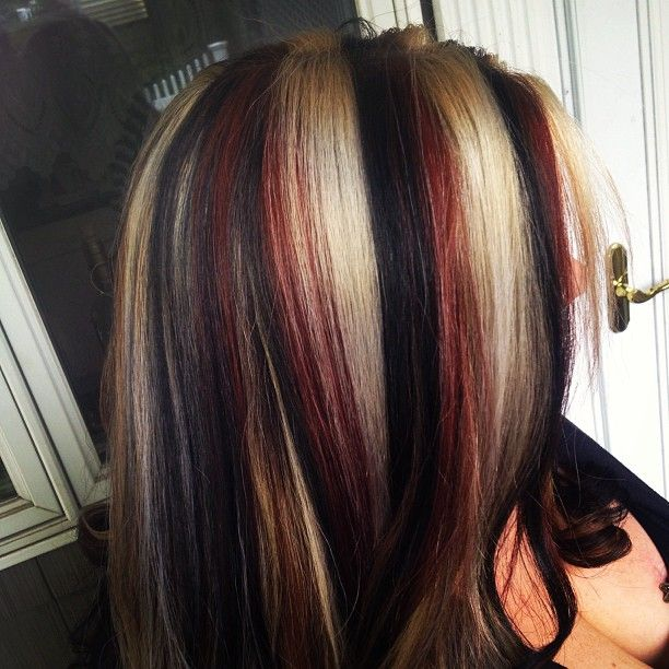 Red and blonde highlights in black hair