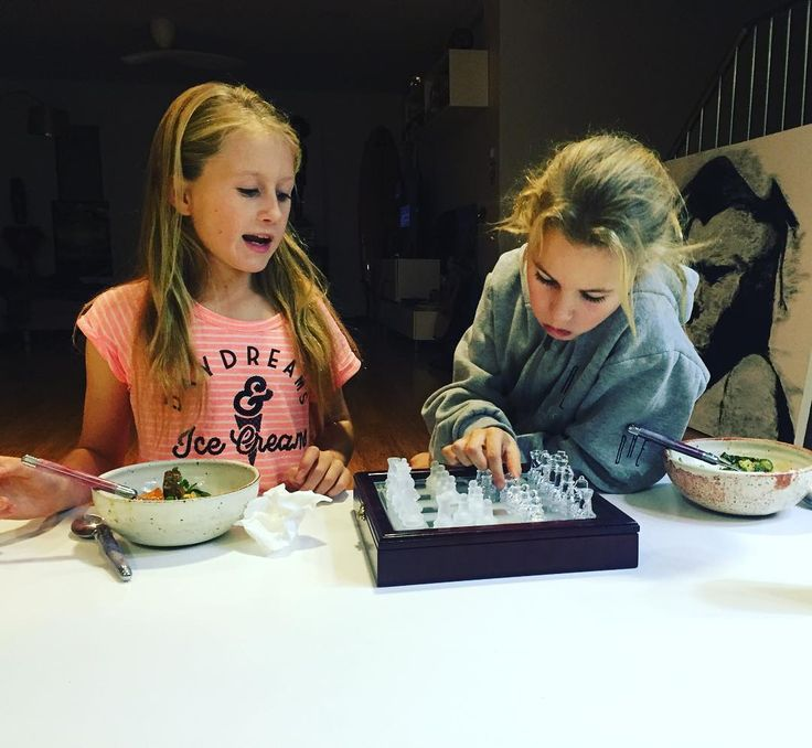 Priceless. The girls decided to bring out the chessboard tonight while taste testing a new #paleo organic curry sauce recipe we are working on.  It is in a yummy flathead and vegetable curry. The girls did chess club from kindy onwards for a few years at their public school. #chessistheshizz by chefpeteevans
