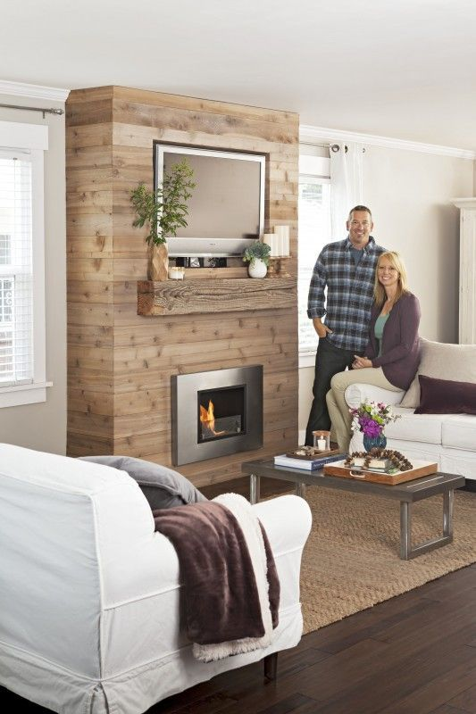 Create this rustic DIY fireplace wall yourself! This update creates a lot of style and warmth, but it also stores your media center by keeping the flat screen neatly tucked above the fireplace.