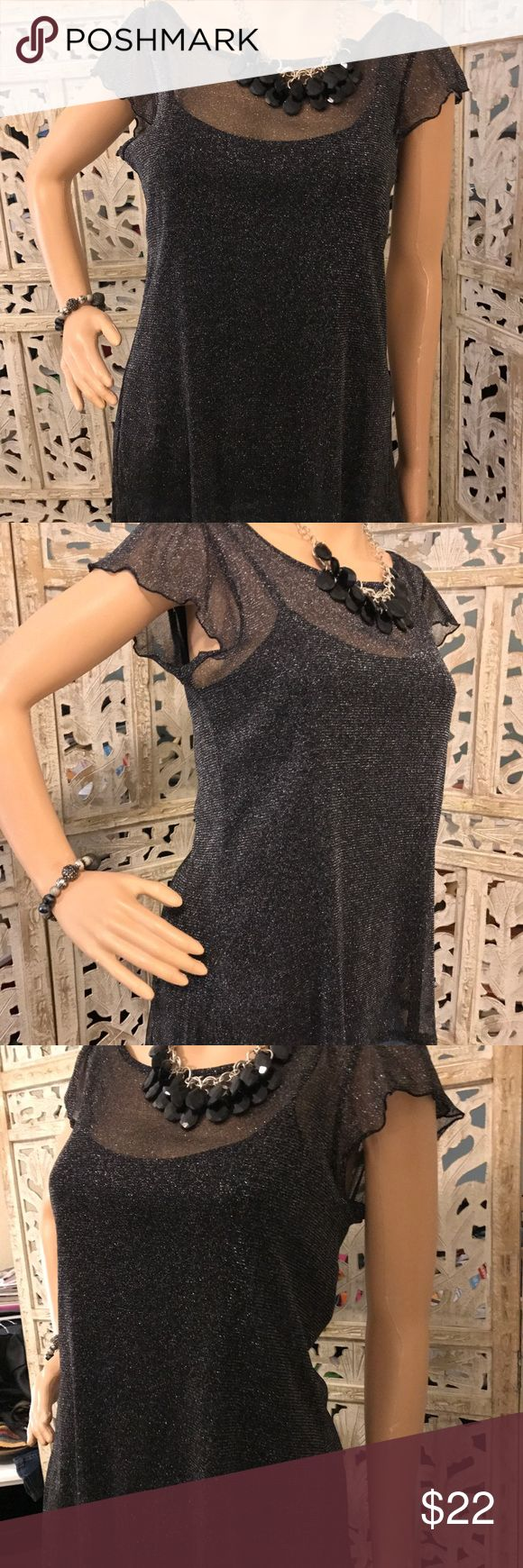 See thru bling shirt with tank attached This is a very elegant black sheer blouse with an attached black tank top. It has been previously Loved but still in good condition. No tears or stains. HeartSoul Tops Blouses