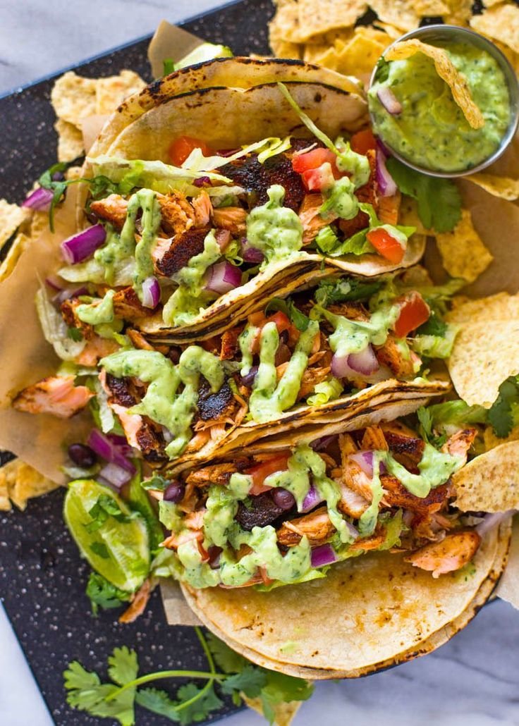 Crispy blackened salmon topped with lettuce, tomato, onion and a drizzle of our favorite homemade creamy tomatillo avocado salsa. These salmon tacos are loaded with flavor and spice and will become…