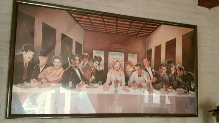 """Painting called: """"The Last Supper"""", I bought it in 1995. At that time the only living actor was Marlon Brando. From left to right: Oliver Hardy, Stan Laurel, Elvis Presley, Clark Gable, John Wayne, Charlie Chaplin,MARILYN MONROE, James Dean,Humprey Bogart,Fred Astaire, Gary Grant, Frankenstein (Boris Karloff) and Marlon Brando."""