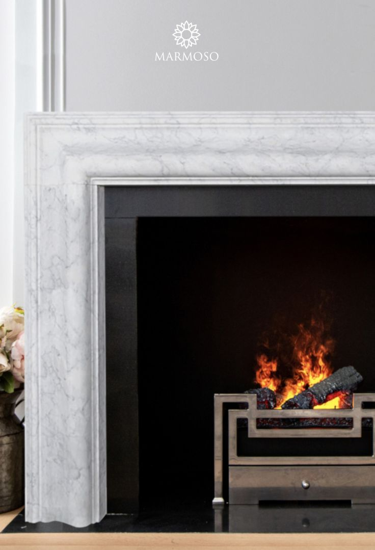 Modern marble fireplace surround by Marmoso