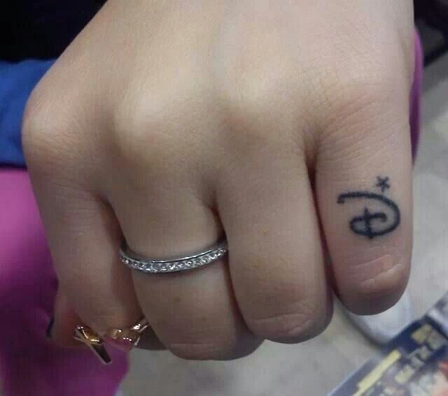 Small Disney Tattoo on pinky finger, so cute!