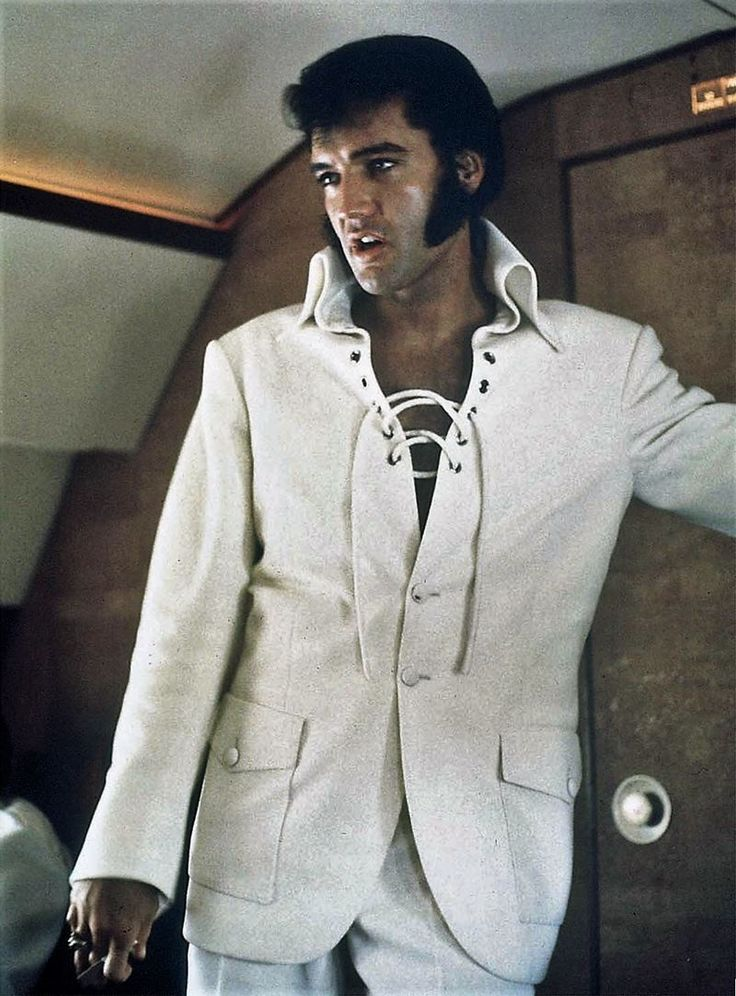 Ed Bonja took this photo of Elvis Presley on board of his private jet on Tuesday, September 15, 1970 as he was leaving Mobile, AL to fly home to Beverly Hills, CA. Elvis had been on tour from September 9 to September 14, 1970 which meant 8 shows in 6 different cities and 5 States; Arizona, Missouri, Michigan, Florida and Alabama. Ed Bonja was Elvis Presley's official photographer from 1970-1977. His uncle Tom Diskin was Elvis's tour manager and Colonel Parker's right hand.