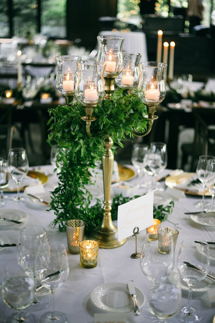 Rustic Candelabra Centerpiece - I like the idea of simple greenery and candles more than flowers