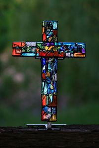 "Coat of Many Colors Glass Cross 10"" - Coat of Many Colors glass cross. From the Old Testament, representing Joseph's Coat of many colors."