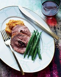 This fantastic duck breasts roast features an incredible sweet-and-sour cherry stuffing seasoned with parsley and thyme.