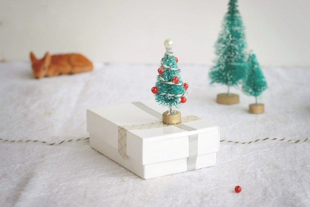 DIY Mini Christmas Tree Gift Wrap Embellishment with Tiny Bottle Brush Trees