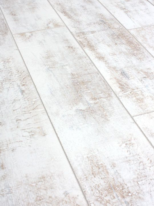 Packs of Distressed White laminate flooring 12mm AC4 Click distressed More