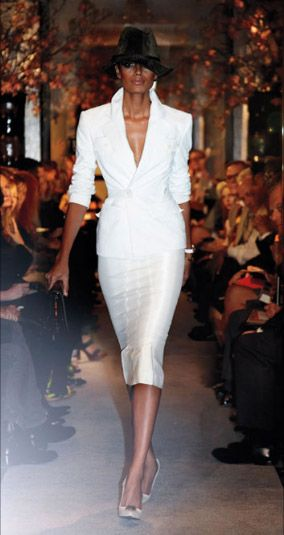 Model Joan Smalls shows off an all white skirt suit at the Tom Ford 2011 Spring fashion show in NYC.