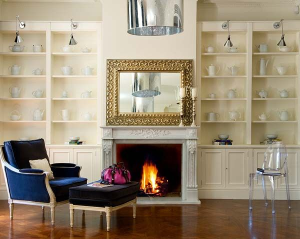 we are big on storage...bespoke library to fit all of your design reference books...or in the case of your kindle, leaves one room to display the infamous white teapot collection!  designed by us @ nikohl cadeau interiors
