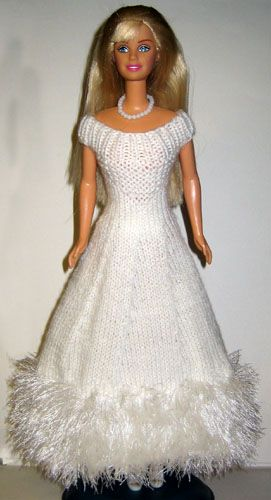 Large number of knit and crochet doll clothes, mostly for fashion dolls