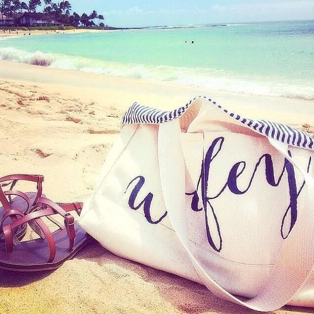 Honeymoon Ready Lauradesilet Soaking Up The Rays With Her Ily Wifey Beach Tote Takeus Want My Pinterest Wedding In 2018