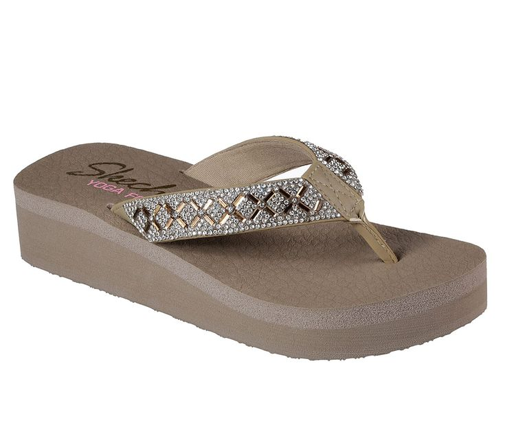 Idlyllic comfort combines with sparkling style in the SKECHERS Cali Vinyasa sandal. Smooth synthetic upper with glittering mini rhinestone gem detail in a low wedge heeled flip flop casual thong sandal. Yoga Foam comfort footbed.