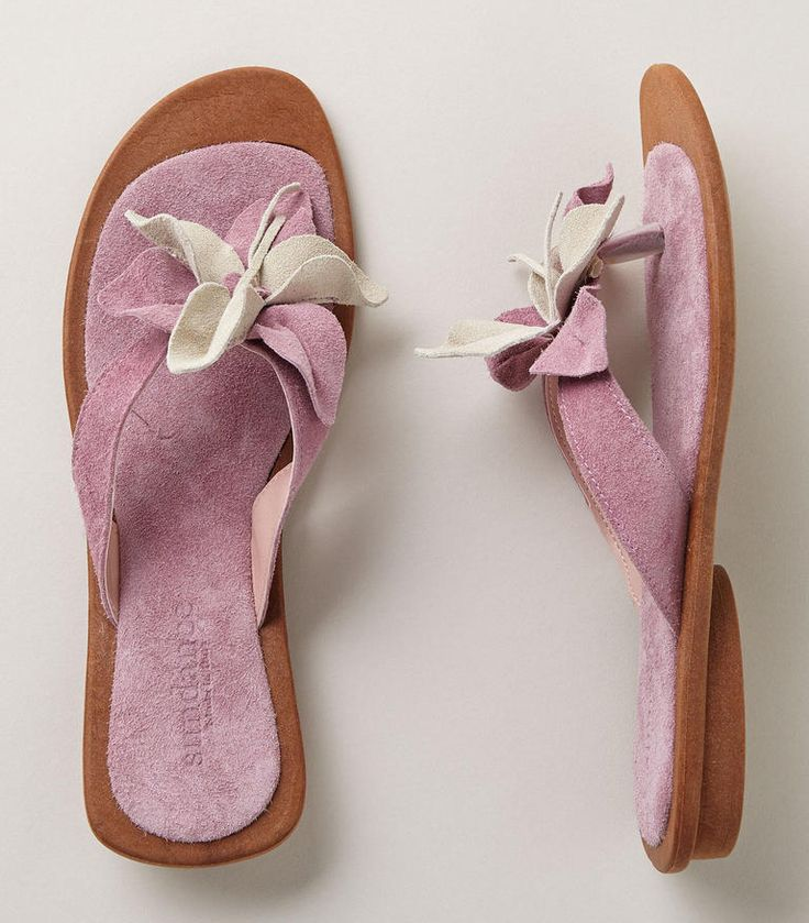 Bursting with beauty, these floral suede thong sandals will bring your look to life. http://zocko.it/LD4Nu