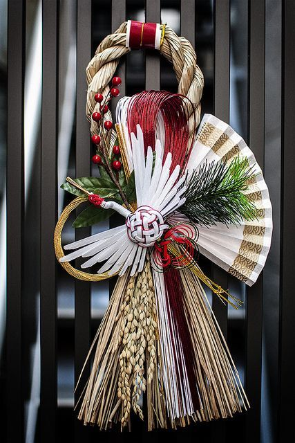 """Shimekazari""  in Asakusa, Tokyo, Japan.    Many Japanese decorate the entrances of their homes with Shimekazari during the New Year's season to ward off evil spirits. They are made of Shimenawa, sacred Shinto rope of rice straw, used to indicate the sacred areas where gods descend."
