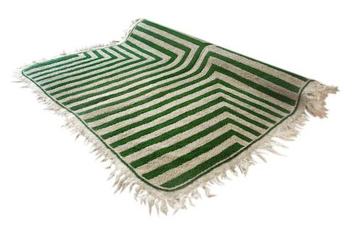 MEZE CARPET by TIKAU / Materials: Hand felted rug and hand embroidered pattern. Felted wool, 3 –5 % cotton, woollen embroidery. Size:  120 x 170 cm (size without the fringe). Colors: green