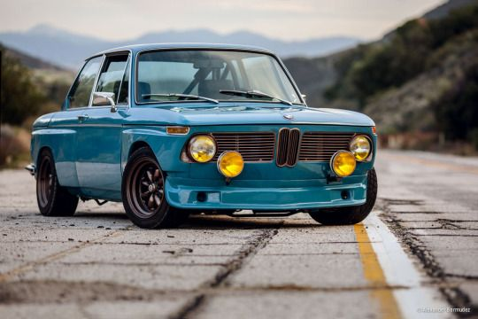"""I like to think of Jesus as a mischievous badger.""  Whatever that means. I love the early 70s 2002 BMW's, its a shame that even a rough one costs an arm and a leg."