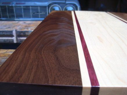 Sooo beautiful! I want to make one of these... Black walnut, maple and purple heart cutting board