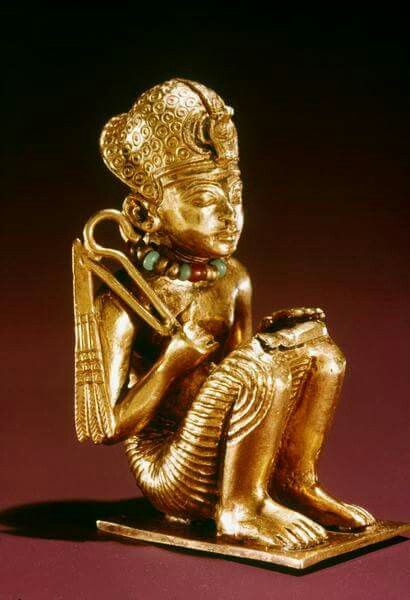 Tiny solid gold statuette of Amenhotep III found in a small mummiform coffin in the Tomb of Tutankhamun.