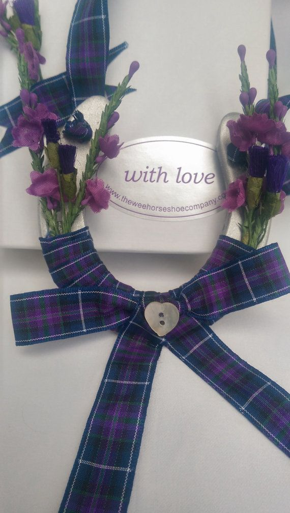 We are The Wee Horseshoe Company we make hand crafted wedding horseshoes for giving to a bride on her big day. Here is our Pride Of Scotland shoe. The deep colours in this tartan are just lovely with purple,dark green, navy blue and a fine white stripe. It is decorated with purple