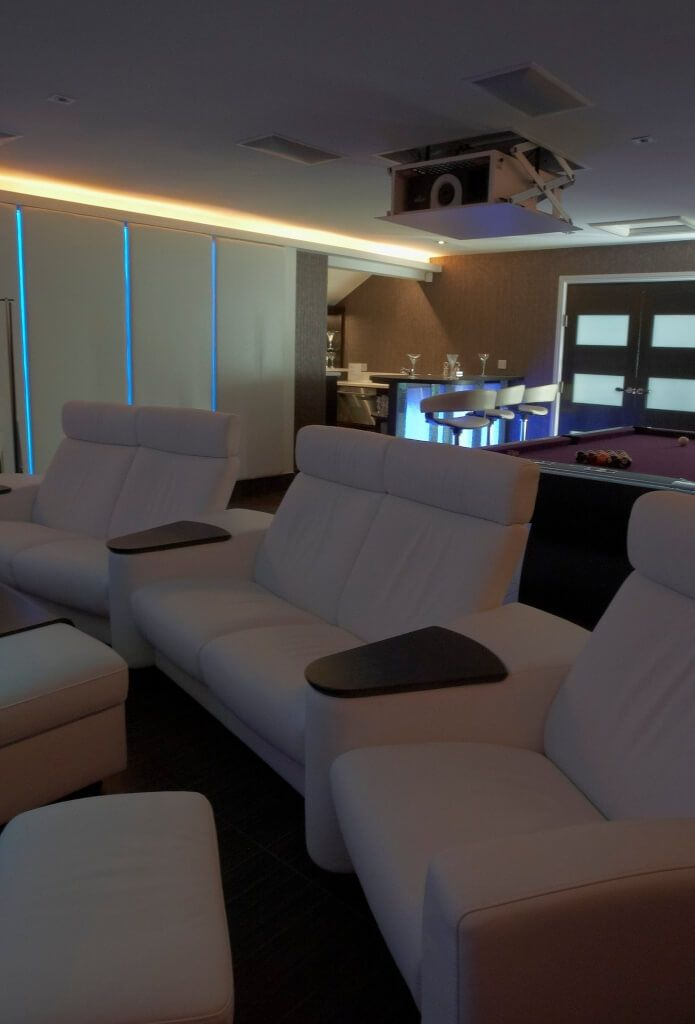 Games Room With Drop Down Home Cinema Projector And Seats
