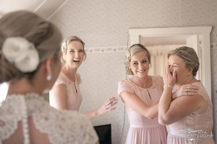 Being a bridesmaid is an important and emotional job, as captured here in this wedding photo. Check out other wedding photography by Anthony Turnham at www.snapweddingphotography.co.nz