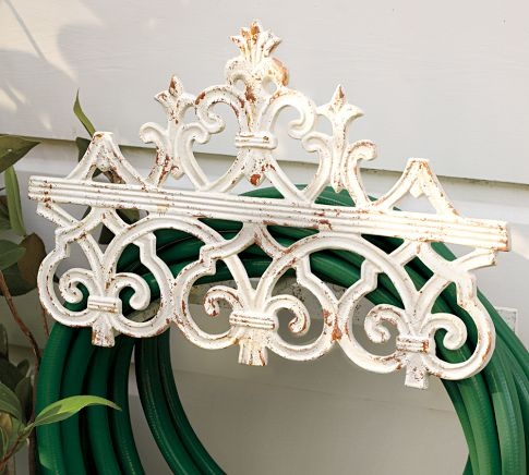 Why should the garden hose holder be ugly?  Potterybarn, of course, makes it beautiful.