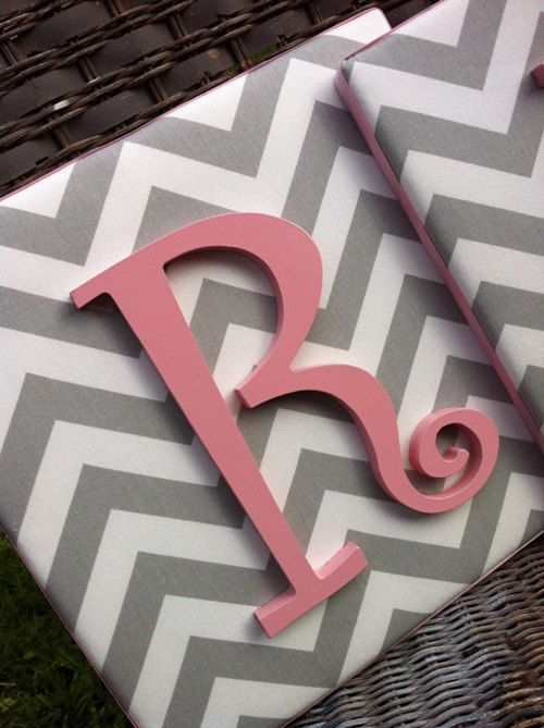 Use a canvas, cover in fabric and paint wooden letters to match room decor...love love love chevron!