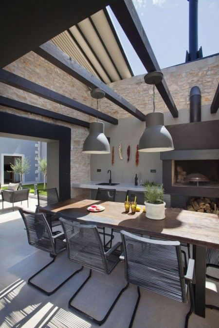 9. outdoor dining - wood table with black chairs and light fixtures