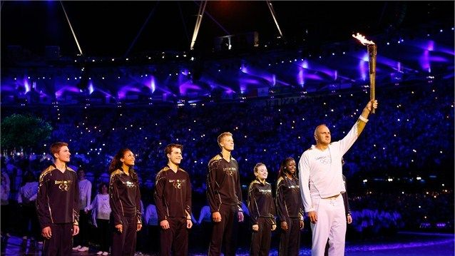 Torchbearer Sir Steve Redgrave stands with the Olympic Flame during the Opening Ceremony of the London 2012 Olympic Games at the Olympic Stadium. The rower won gold medals at five successive Olympic Games from 1988 to 2000. Sir Chris stands in front of Young Torchbearers, six talented athletes nominated by former British Olympic legends.