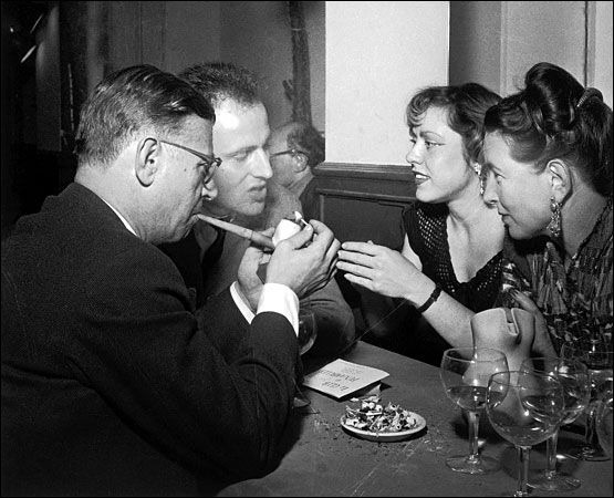 Jean- Paul Sartre in Paris in 1952, with Simone de Beauvoir, right, and the writer and musician Boris Vian and his wife, Michelle