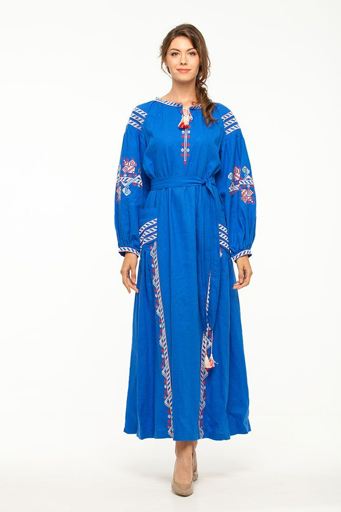 A gorgeous blue linen dress with symbolic red-white embroidery is a great acquisition for those women having a sense of style and good taste. This dress is a real godsend for future brides who want to impress their beloved and wedding guests in an incredible way. Вишита сукня «Молода лілія» волошкова