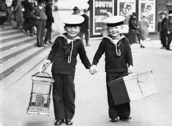 Two boys dressed as sailors outside a London Tube station in the 1920s.