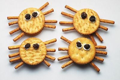 Creepy Crawlies-Spider Snack  Make a peanut-butter cracker sandwich. Insert 4 thin pretzel-stick halves into the filling on each side. Top with 2 raisins dipped in cream cheese. (lajollamom.com)