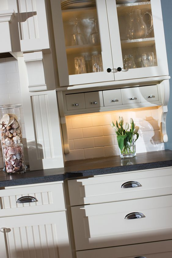 Beaded panel is featured in the cabinet door style while for Add drawers to kitchen cabinets