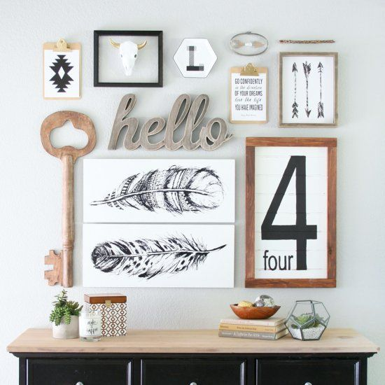 Creating a gorgeous focal wall like this Black & White Gallery Wall has never been easier with some simple tips and tricks.