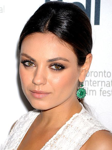 "Mila Kunis's Nam Cho ""Bull's Eye"" emerald-and-diamond danglers from Fragments will set your husband back $37,500."